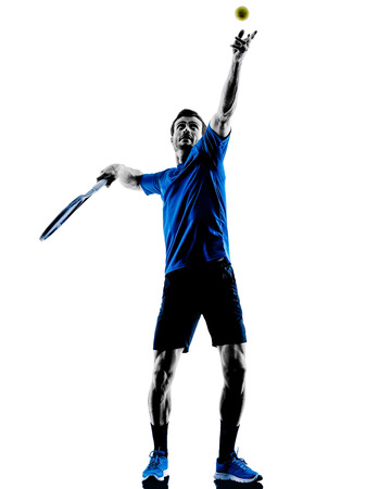 one caucasian man playing tennis player in studio silhouette isolated on white background Stock Photo