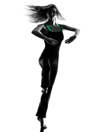 sport woman: one woman dancer dancing in studio silhouette isolated on white background