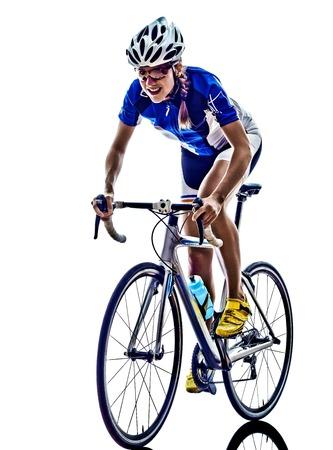 white  background: Mujer triatl�n ironman ciclismo ciclista atleta en el fondo blanco Foto de archivo