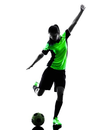 one woman playing soccer player in silhouette isolated on white background Фото со стока