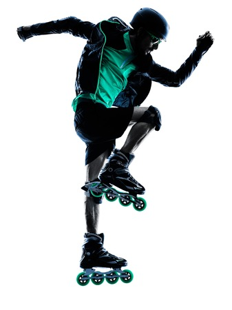 inline skating: one caucasian man Roller Skater inline  Roller Blading in silhouette isolated on white background