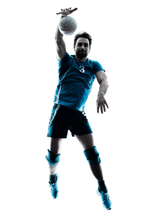volleyball: one caucasian man volleyball jumping in studio silhouette isolated on white background in studio silhouette isolated on white background