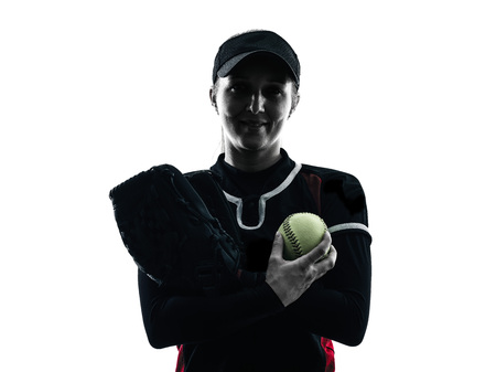 one woman playing softball players in silhouette isolated on white background photo