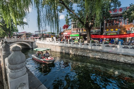 china people: Beijing , China - September 24, 2014:  Chinese traditional Yindingqiao Hutong streets with people and tourist Beijing China