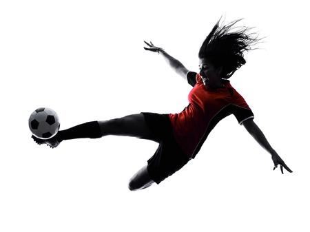 una mujer jugador de jugar al fútbol en la silueta aislado en el fondo blanco Foto de archivo