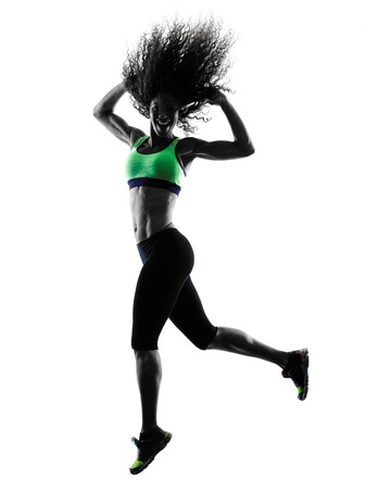 practicing: one african woman woman zumba dancer dancing exercises  in studio silhouette isolated on white background Stock Photo