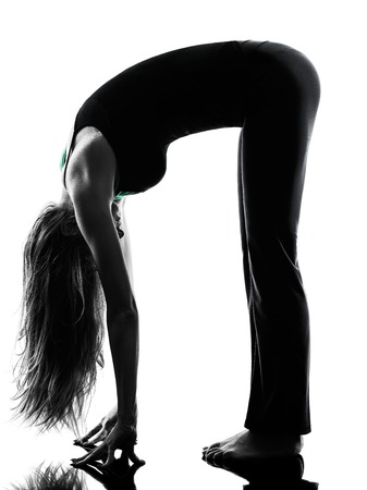 one woman dancer stretching warming up exercises in studio silhouette isolated on white background Stock Photo