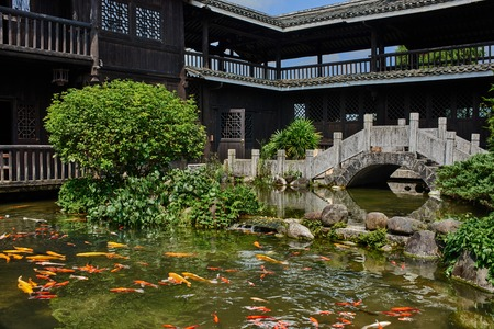 koi fish pond: koi fish pond in a traditional house of Shangri La between Guilin and Yangshuo in Guangxi province  China