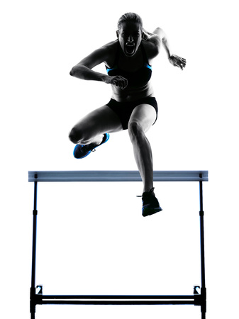 hurdling: one  caucasian woman hurdlers  hurdling in silhouette isolated white background