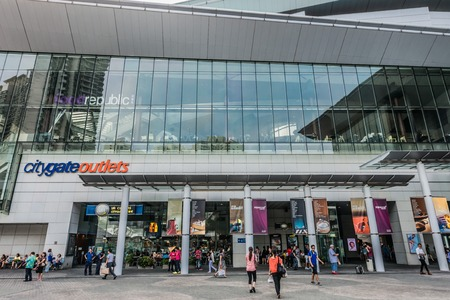 lantau: Tung Chung Wan, Hong Kong, China- June 11, 2014: people outside the CityGate Outlet shopping mall in Lantau island near the airport Editorial