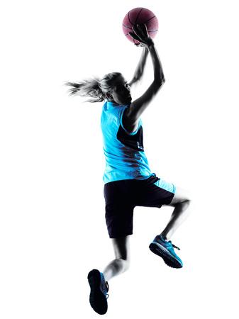 een blanke vrouw basketbalspeler dribbelen in silhouet geïsoleerd witte achtergrond Stockfoto