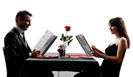 couple dining: couples lovers dinning reding menu in silhouettes on white background