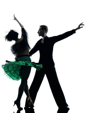 dancer: one caucasian elegant couple dancers dancing in studio silhouette isolated on white background