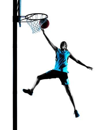 baloncesto: un caucásico mujer del jugador de baloncesto goteo en silueta aislado fondo blanco Foto de archivo