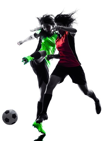 women playing soccer: two women playing soccer players in silhouette isolated on white background