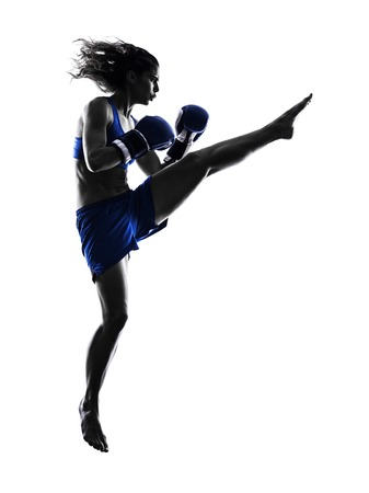 kickboxing: one woman boxer boxing kickboxing in silhouette isolated on white background Stock Photo