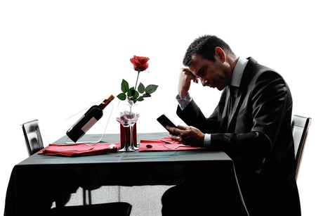 sad man alone: one man waiting dinning in silhouettes on white background Stock Photo