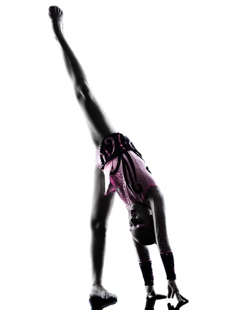 ginnastica ritmica: one caucasian little girl child  exercising Rhythmic Gymnastics in silhouette isolated on white background