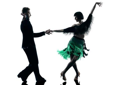 baile moderno: un cauc�sico elegantes bailarines pareja bailando en el estudio de silueta aislados sobre fondo blanco
