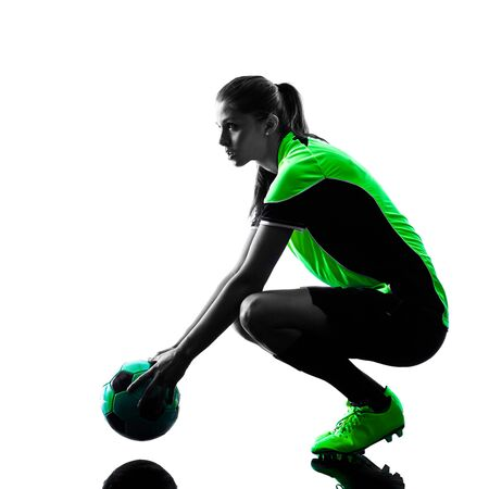 soccer player: one woman playing soccer player in silhouette isolated on white background Stock Photo