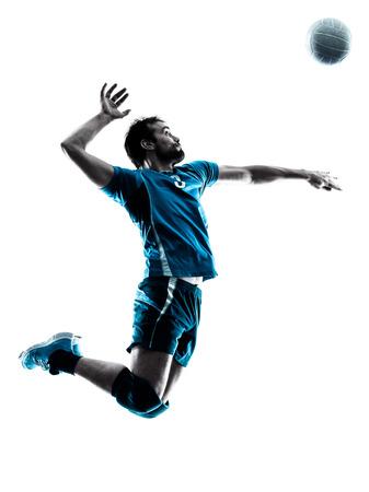 voleibol: un hombre caucásico de voleibol saltando en el estudio de silueta aislados sobre fondo blanco en el estudio de la silueta aislado en el fondo blanco Foto de archivo