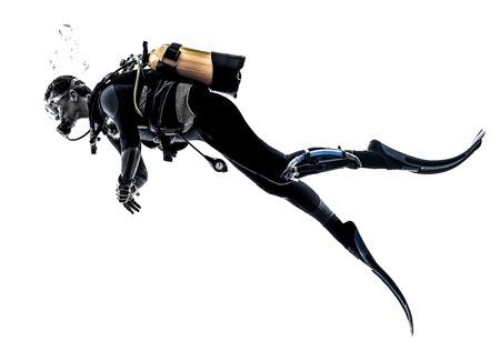 dive: un cauc�sico scuba hombre zambullida en la silueta del estudio aislada en el fondo blanco Foto de archivo
