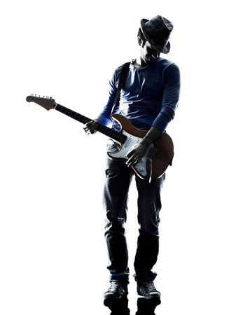 shadow man: one caucasian man electric guitarist player playing in studio silhouette isolated on white background