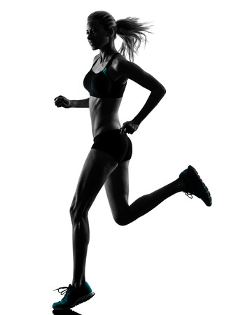 woman running: one caucasian woman runner running jogger jogging  in studio silhouette isolated on white background Stock Photo