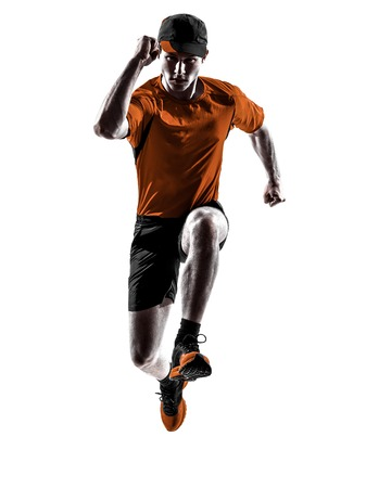one young man runner jogger running jogging jumping in silhouette isolated on white background Stock Photo