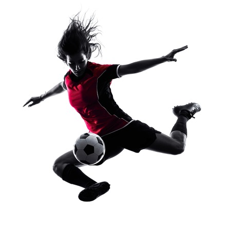 woman shadow: one woman playing soccer player in silhouette isolated on white background Stock Photo
