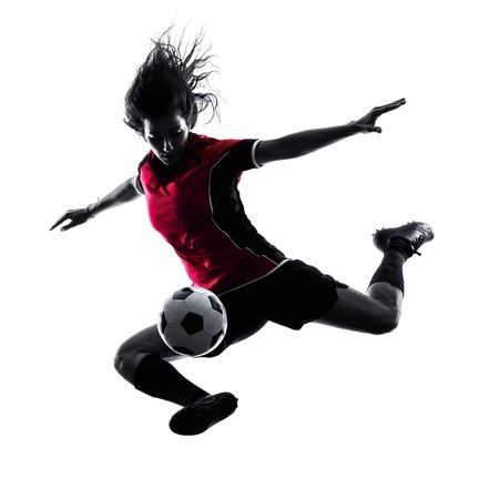 soccer: una mujer jugador de jugar al f�tbol en la silueta aislado en el fondo blanco Foto de archivo