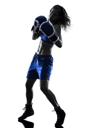 martial arts woman: one woman boxer boxing kickboxing in silhouette isolated on white background Stock Photo