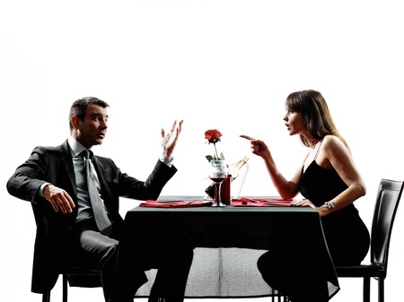 dispute: couple lovers dinning dispute arguing in silhouettes on white background Stock Photo
