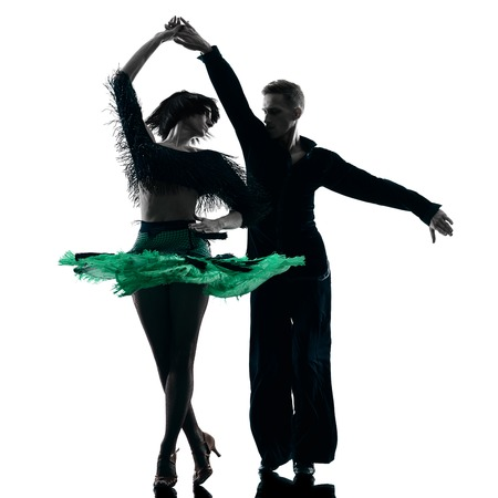caucasian elegant couple dancers dancing in studio silhouette isolated on white background