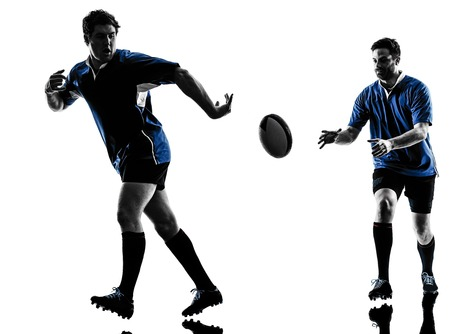 teammates: caucasian rugby men players  in studio  silhouette isolated on white background Stock Photo