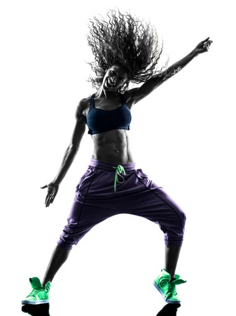 break dancer: one african woman woman dancer dancing exercises  in studio silhouette isolated on white background