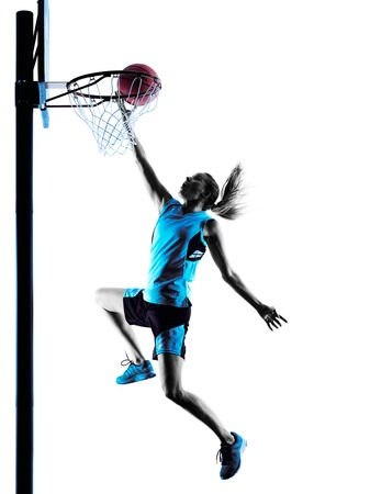 dribbling: one  caucasian woman basketball player dribbling in silhouette isolated white background