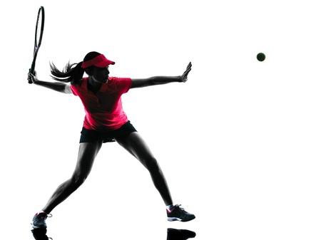 tenis: tenista una mujer en el estudio de la silueta aislado en el fondo blanco Foto de archivo