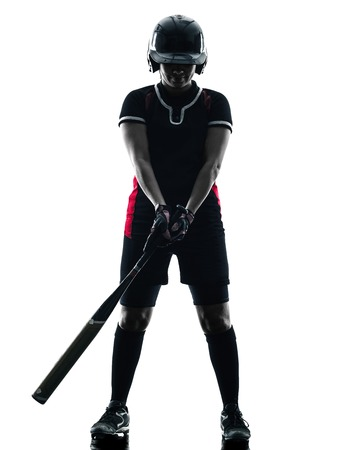 softball: one woman playing softball players in silhouette isolated on white background