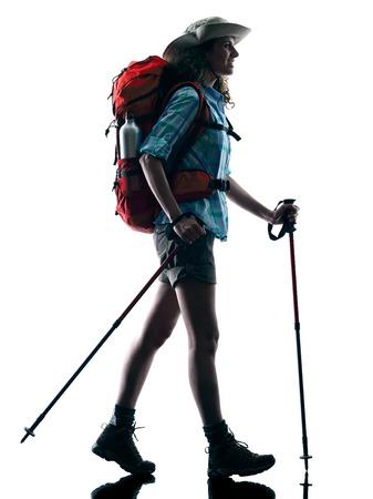 trekker: one caucasian woman trekker trekking walking nature in silhouette isolated on white background Stock Photo