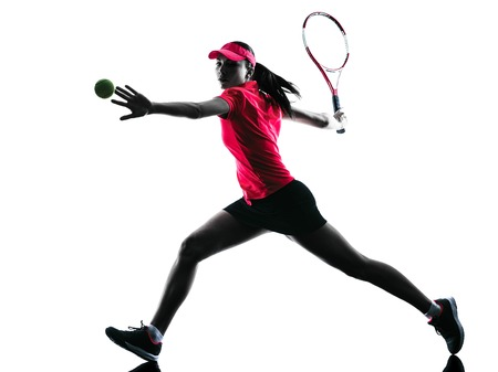 in action: one woman tennis player sadness in studio silhouette isolated on white background