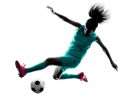 women playing soccer: one teenager girl child  playing soccer player in silhouette isolated on white background Stock Photo