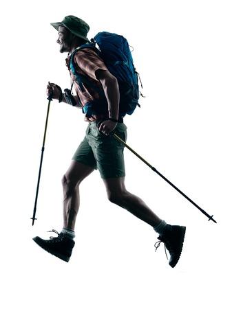 trekker: one caucasian man trekker trekking running happy  in silhouette isolated on white background Stock Photo