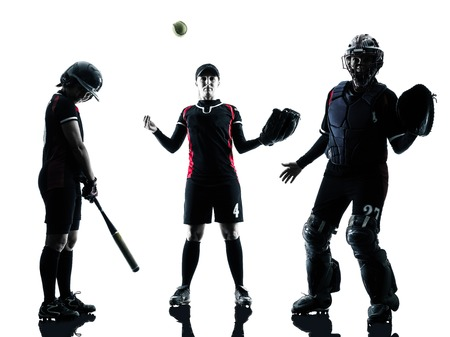 softball: women playing softball players in silhouette isolated on white background