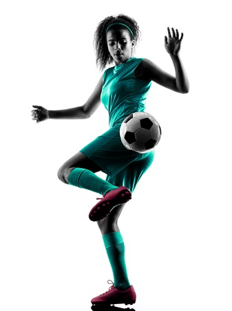 soccer players: one teenager girl child  playing soccer player in silhouette isolated on white background Stock Photo