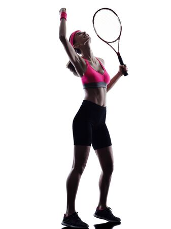 winning woman: one woman tennis player  in studio silhouette isolated on white background
