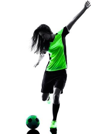 jugadores de futbol: una mujer jugador de jugar al fútbol en la silueta aislado en el fondo blanco Foto de archivo