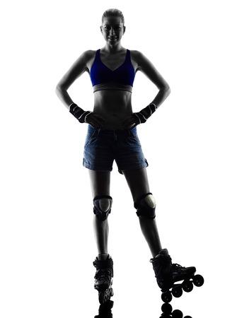 iluminado a contraluz: una mujer en patines estudio de la silueta aislado en el fondo blanco Foto de archivo