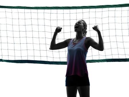 iluminado a contraluz: un caucásico mujer de voleibol en el estudio de la silueta aislado en el fondo blanco