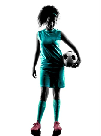 girl sport: one teenager girl child  playing soccer player in silhouette isolated on white background Stock Photo